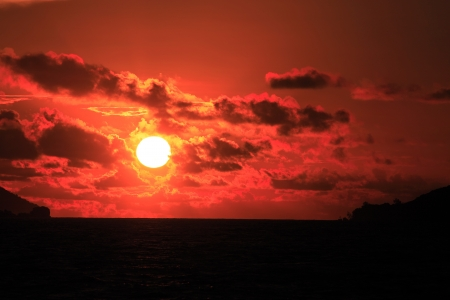 sailling: view from a sailling boat of a sunset on saint anne s bay in praslin seychelles islands indian ocean