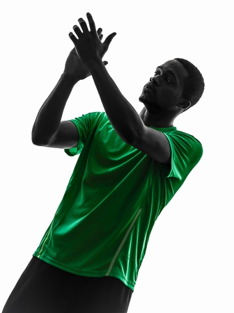 thankful: one african man soccer player applauding green jersey in silhouette  on white background Stock Photo