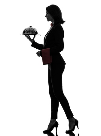 one caucasian woman waiter butler serving dinner with catering dome in silhouette  on white background photo