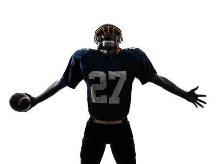 jugador de futbol americano: un jugador de f?tbol americano cauc?sico hombre triunfante en el estudio de la silueta aislado en el fondo blanco