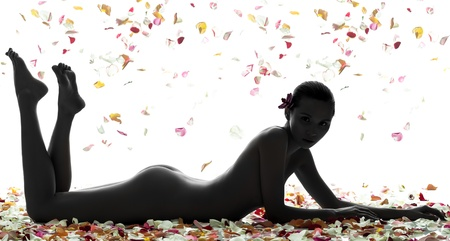 one beautiful asian woman naked lying  with petal flowers  in silhouette studio isolated on white background photo