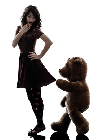 maniac: one caucasian strange young woman and vicious teddy bear  in silhouette white background