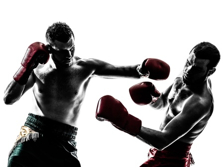 people fighting: two caucasian  men exercising thai boxing in silhouette studio  on white background