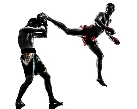 combative: two caucasian  men exercising thai boxing in silhouette studio  on white background
