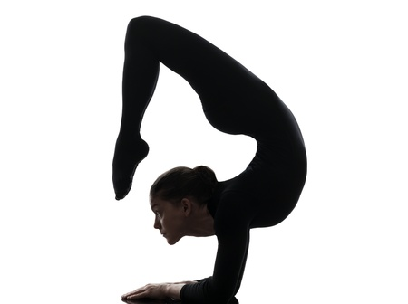one caucasian woman contortionist practicing gymnastic yoga  in silhouette   on white background