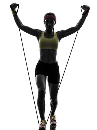 body builder: one  woman exercising fitness workout resistance bands in silhouette  on white background Stock Photo