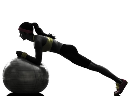 body silhouette: one  woman exercising plank position on fitness ball in silhouette  on white background