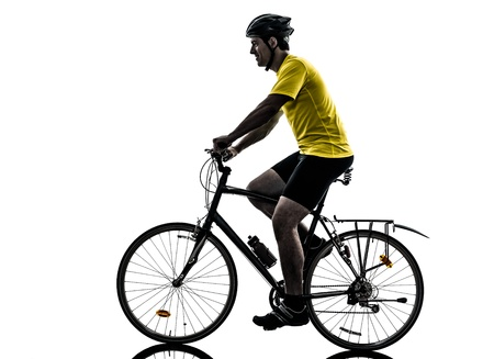 one caucasian man exercising bicycle mountain bike   on white background photo