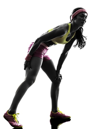 one caucasian woman runner running pain muscle cramp in silhouette on white background photo