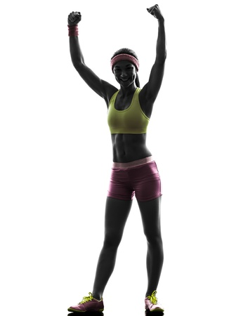 one caucasian woman exercising fitness  fitness arms raised     in silhouette on white background