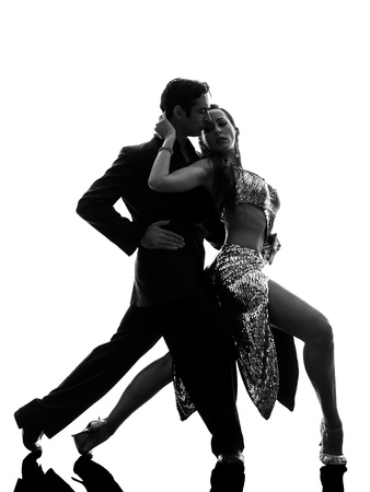 one caucasian couple man woman ballroom dancers tangoing  in silhouette studio isolated on white background Reklamní fotografie