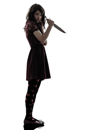 one caucasian strange young woman killer holding  bloody knife in silhouette white background photo