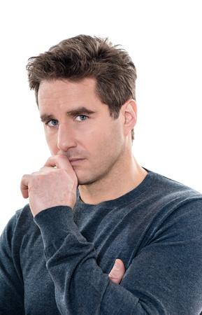 mistrust: one caucasian man mature serious suspicious portrait studio  white background