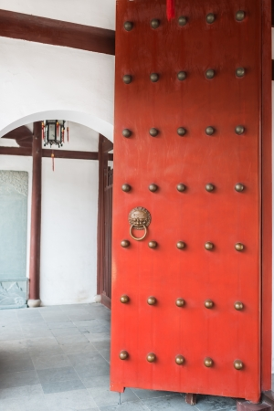 miao: red doors detail of Wen Miao confucian confucius temple in shanghai china popular republic