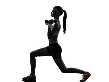 Exercising: one  woman exercising fitness workout lunges crouching weight training  in silhouette  on white background