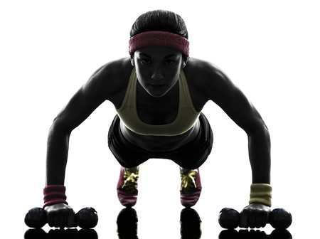 woman shadow: one  woman exercising fitness workout push ups  in silhouette  on white background