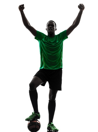 one african man soccer player celebrating victory green jersey in silhouette  on white background Reklamní fotografie
