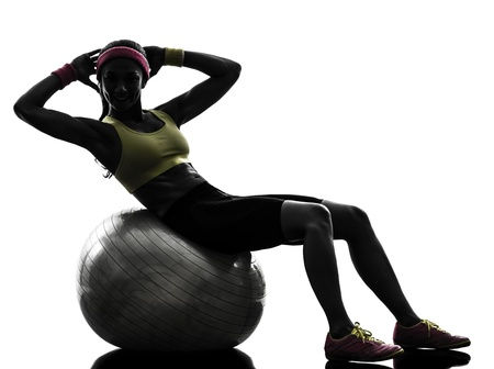 one  woman exercising crunches workout on fitness ball in silhouette  on white background Stock Photo