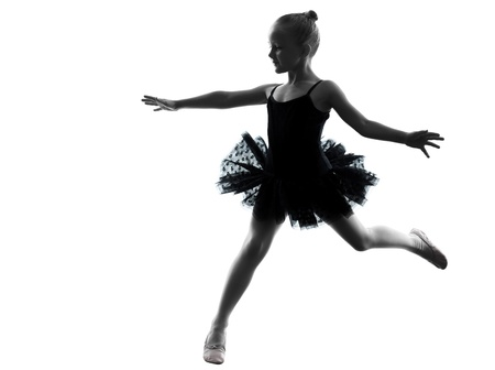 one little girl  ballerina ballet dancer dancing in silhouette on white background photo