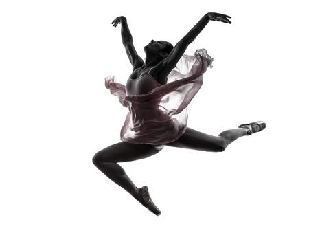 白い背景のシルエットで踊る一人の女性バレリーナのバレエ ダンサー 写真素材