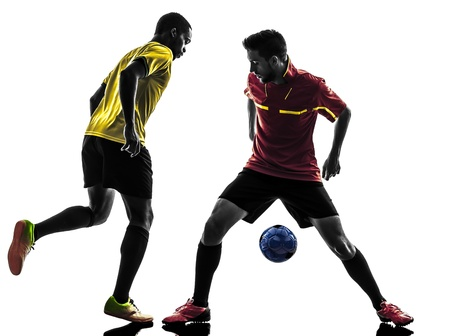 indoor soccer: two men soccer player playing football competition in silhouette  on white background