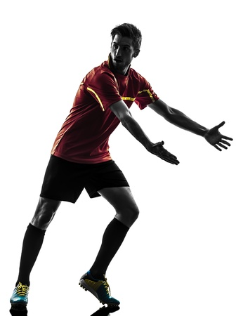 complaining: one man soccer player  complaining playing football competition in silhouette  on white background Stock Photo