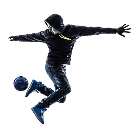freestyle: one caucasian young man soccer freestyler player  in silhouette  on white background