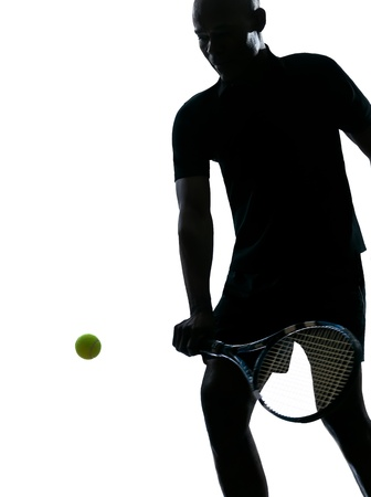 man african afro american playing tennis player backhand on studio isolated on white background silhouette photo
