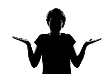 one caucasian young teenager silhouette boy or girl  ignorant hesitation shrugging gesture portrait in studio cut out isolated on white background Stock Photo - 22178669