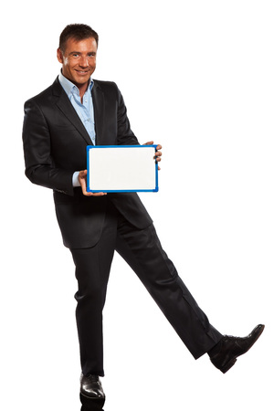 one caucasian business man holding showing whiteboard full length in studio isolated on white background photo