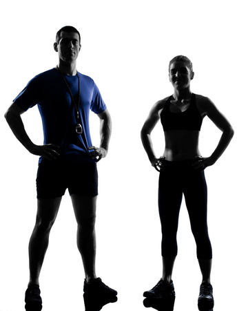 couple woman man exercising workout fitness aerobics instructors posture in silhouette studio isolated on white background photo