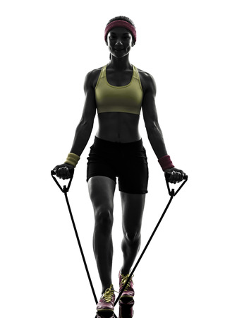 resistance: one  woman exercising fitness workout resistance bands in silhouette  on white background Stock Photo