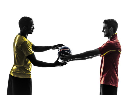 fairplay: two men soccer player playing football competition giving football  in silhouette  on white background