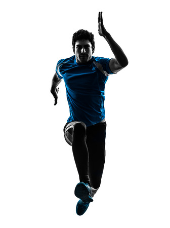 man in shadow: one caucasian man  running sprinting jogging in silhouette studio isolated on white background