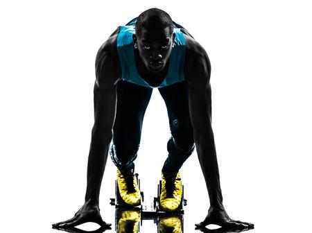 grownups: one caucasian man runner sprinter on starting blocks  in silhouette studio isolated on white background