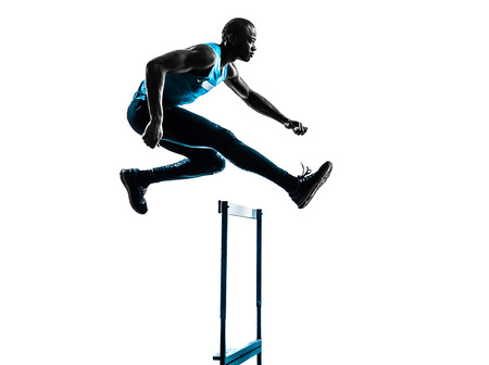 athleticism: one african man hurdler running  in silhouette studio isolated on white background