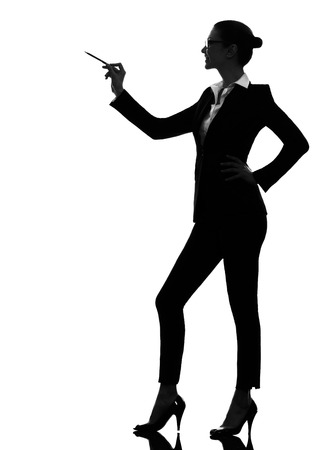 one caucasian business woman holding pen pointing showing in silhouette  on white background photo