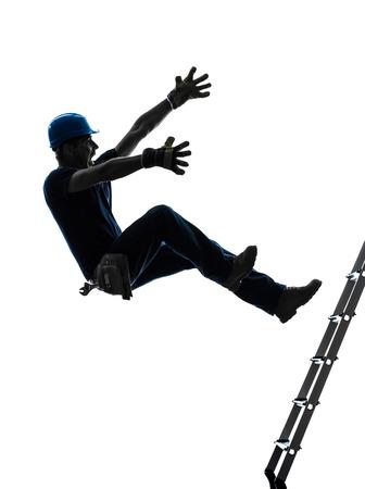 escaleras: un hombre trabajador manual caída desde una escalera en la silueta en el fondo blanco Foto de archivo