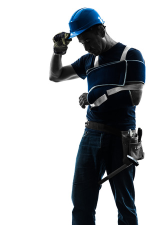 tired worker: one  manual worker man with injury brace in silhouette on white background