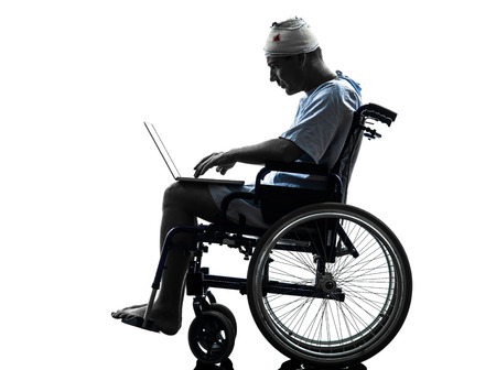 one  injured man in wheelchair  in silhouette studio  on white background photo