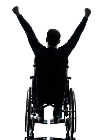 wheelchair man: one handicapped man arms raised  rear view in silhouette studio  on white background Stock Photo