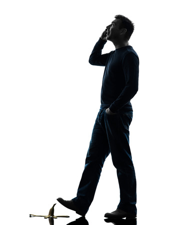 careless: one  man careless man walking on the telephone in silhouette studio  on white background