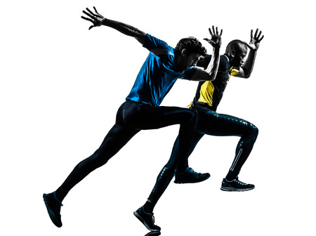 two men racing  running sprinting  in silhouette studio isolated on white background photo