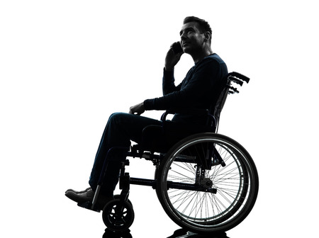 one handicapped man on the telephone in silhouette studio  on white background photo