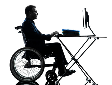 one handicapped business man computing laptop computer in silhouette studio  on white background photo