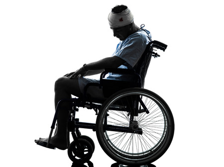 one  injured man in wheelchair sleeping in silhouette studio  on white background photo