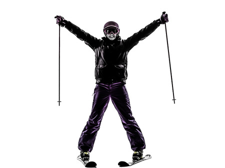 cut the competition: one caucasian woman skier skiing happy joyful  in silhouette on white background