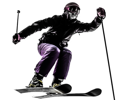 one caucasian woman skier skiing jumping in silhouette on white background photo