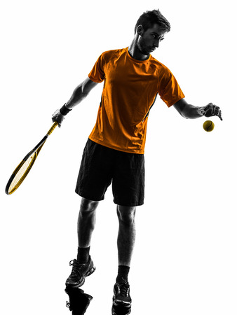 male tennis players: one  man tennis player at service serving silhouette in silhouette on white background