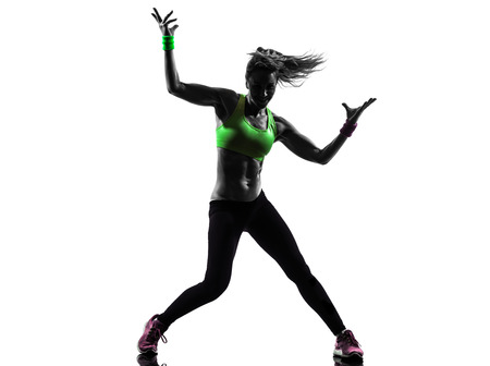 Exercising: one caucasian woman exercising fitness zumba dancing  in silhouette  on white background